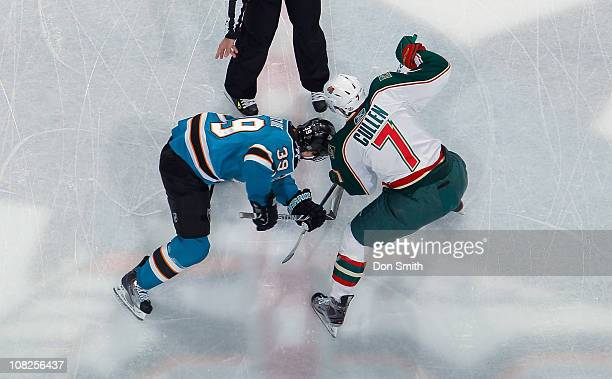 Logan Couture of the San Jose Sharks faces off against Matt Cullen of the Minnesota Wild during an NHL game on January 22 2011 at HP Pavilion at San...