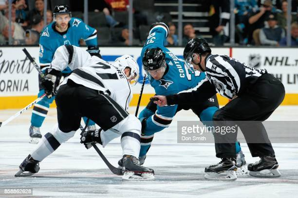 Logan Couture of the San Jose Sharks faces off against Nick Shore of the Los Angeles Kings during a NHL game at SAP Center at San Jose on October 7...
