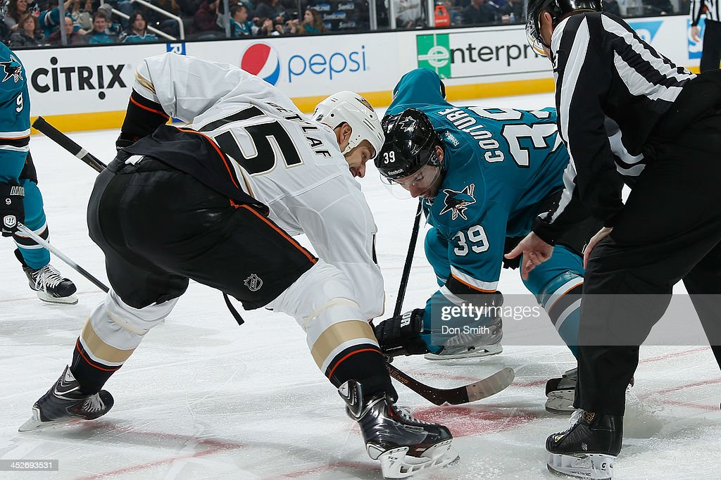 <a gi-track='captionPersonalityLinkClicked' href=/galleries/search?phrase=Logan+Couture&family=editorial&specificpeople=809700 ng-click='$event.stopPropagation()'>Logan Couture</a> #39 of the San Jose Sharks gets ready for a face-off against <a gi-track='captionPersonalityLinkClicked' href=/galleries/search?phrase=Ryan+Getzlaf&family=editorial&specificpeople=602655 ng-click='$event.stopPropagation()'>Ryan Getzlaf</a> #15 of the Anaheim Ducks during an NHL game on November 30, 2013 at SAP Center in San Jose, California.