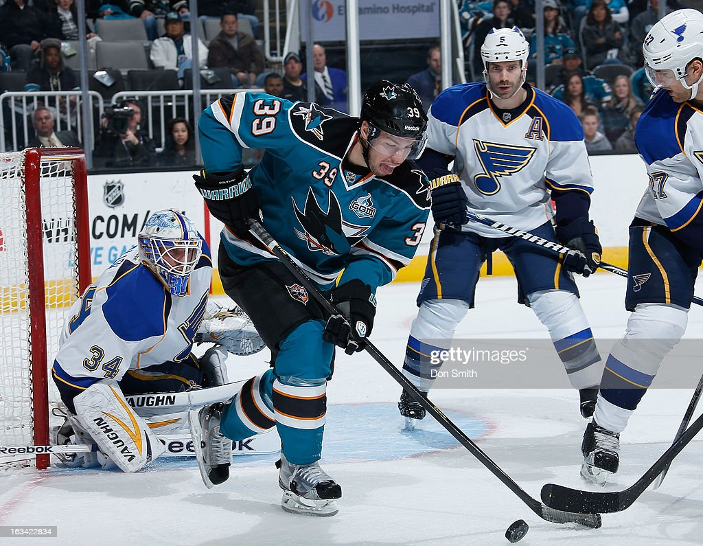 Logan Couture #39 of the San Jose Sharks handles the puck against Jake Allen #34 and Barret Jackman #5 of the St. Louis Blues during an NHL game on March 9, 2013 at HP Pavilion in San Jose, California.
