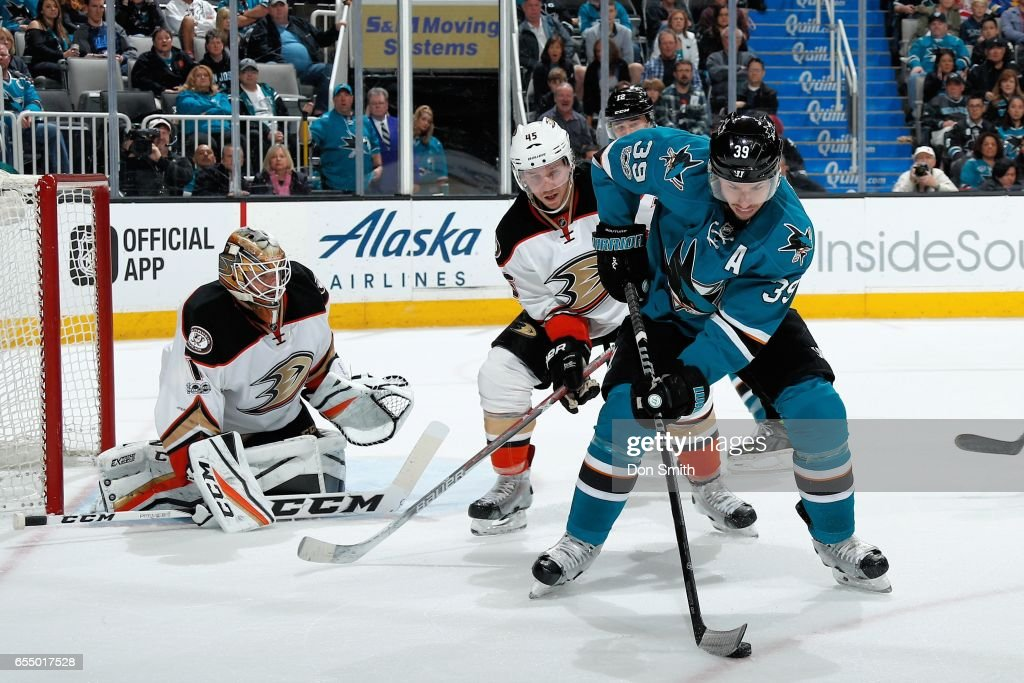 Logan Couture #39 of the San Jose Sharks handles the puck while being defended by Jonathan Bernier #1 and Sami Vatanen #45 of the Anaheim Ducks at SAP Center at San Jose on March 18, 2017 in San Jose, California.
