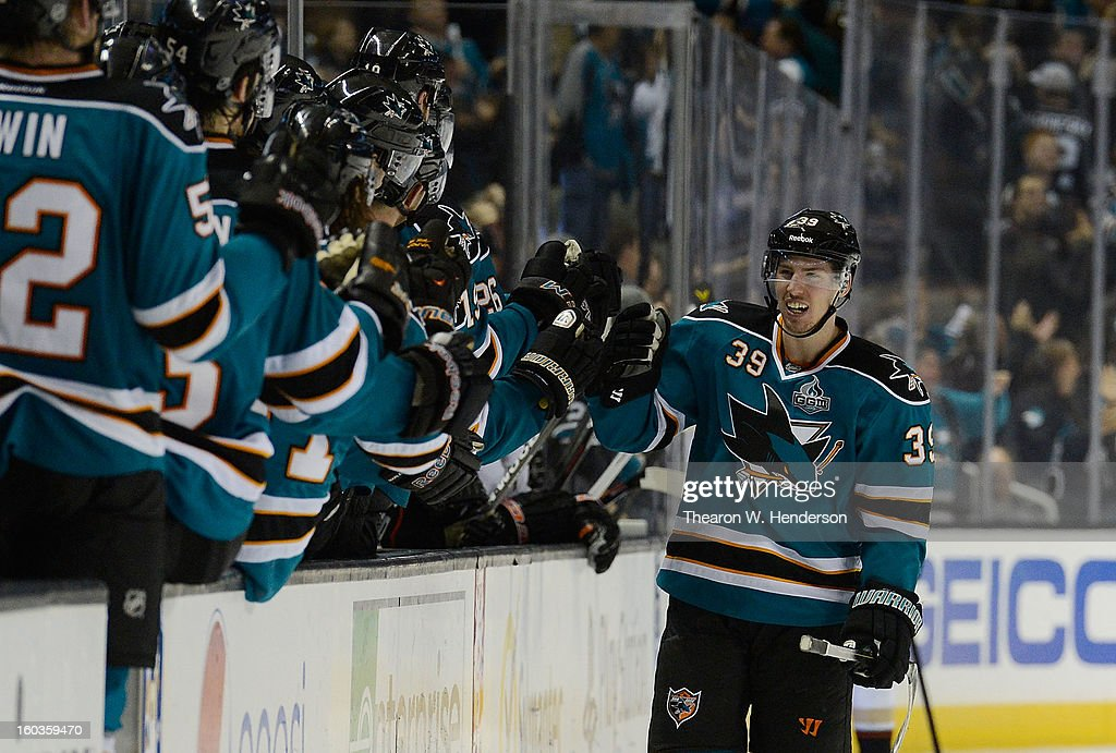 Logan Couture #39 of the San Jose Sharks is congratulated by teammates after Couture scored the tying goal late in the third period against the Anaheim Ducks at HP Pavilion on January 29, 2013 in San Jose, California. The Sharks won the game in an overtime shoot-out 3-2.