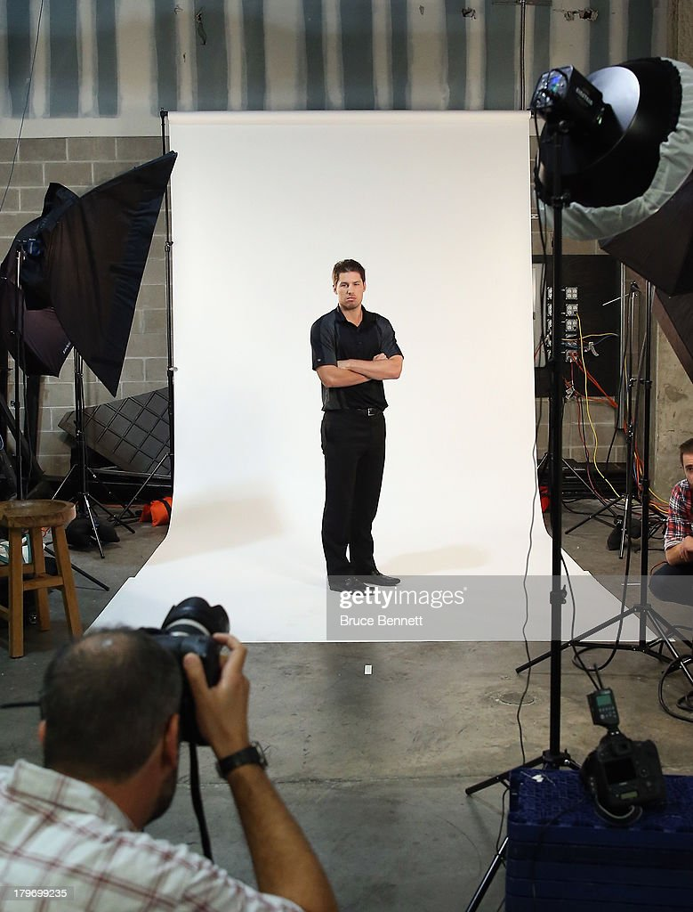 Logan Couture of the San Jose Sharks is photographed in a portrait session during the National Hockey League Player Media Tour at the Prudential Center on September 6, 2013 in Newark, New Jersey.