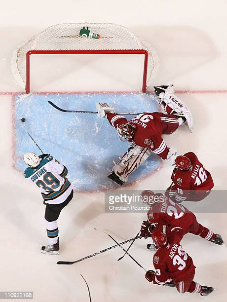 Logan Couture of the San Jose Sharks scores a first period goal past goaltender Ilya Bryzgalov Rostislav Klesla Lee Stempniak and Adrian Aucoin of...