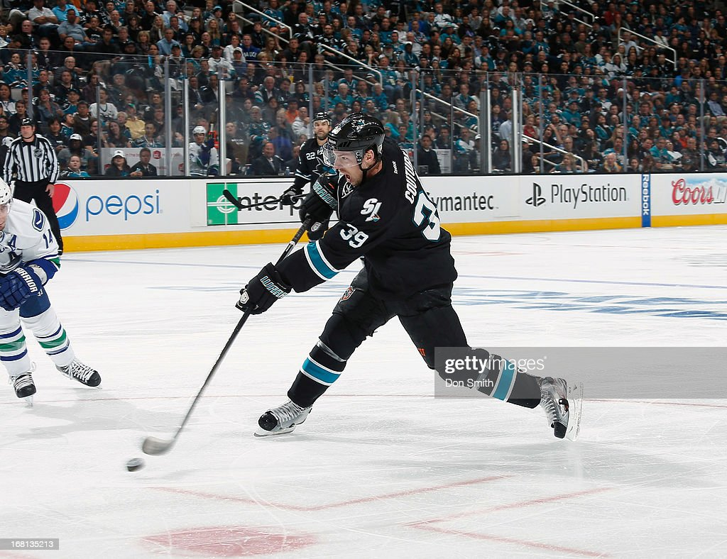 <a gi-track='captionPersonalityLinkClicked' href=/galleries/search?phrase=Logan+Couture&family=editorial&specificpeople=809700 ng-click='$event.stopPropagation()'>Logan Couture</a> #39 of the San Jose Sharks scores a goal against the Vancouver Canucks in Game One of the Western Conference Quarterfinals during the 2013 Stanley Cup Playoffs at HP Pavilion on May 5, 2013 in San Jose, California.
