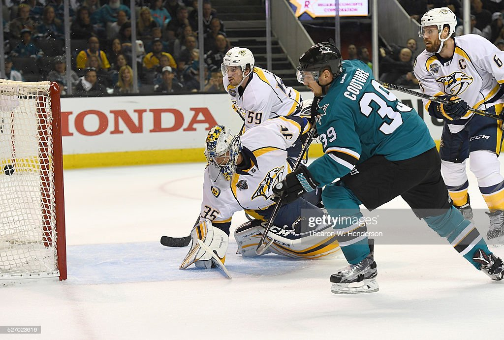 Logan Couture of the San Jose Sharks scores a goal past Pekka Rinne of the Nashville Predators in Game Two of the Western Conference Second Round...