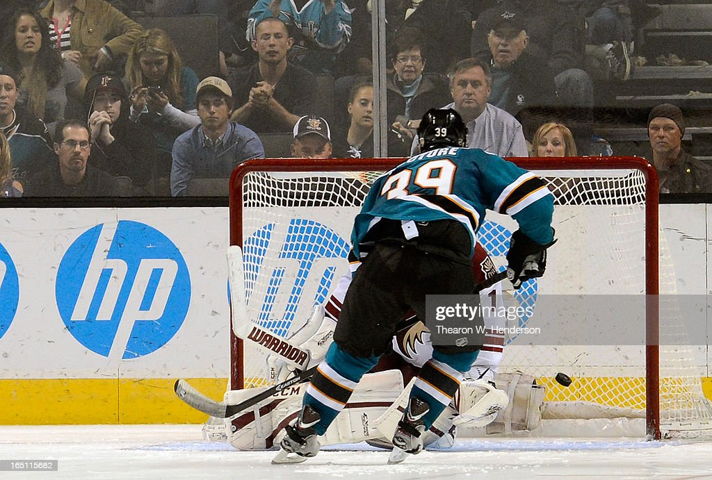 <a gi-track='captionPersonalityLinkClicked' href=/galleries/search?phrase=Logan+Couture&family=editorial&specificpeople=809700 ng-click='$event.stopPropagation()'>Logan Couture</a> #39 of the San Jose Sharks scores getting his shot past goalkeeper <a gi-track='captionPersonalityLinkClicked' href=/galleries/search?phrase=Jason+LaBarbera&family=editorial&specificpeople=240674 ng-click='$event.stopPropagation()'>Jason LaBarbera</a> #1 of the Phoenix Coyotes in an overtime shoot-out at HP Pavilion on March 30, 2013 in San Jose, California. The Sharks won the game 3-2 in the overtime shoot-out.