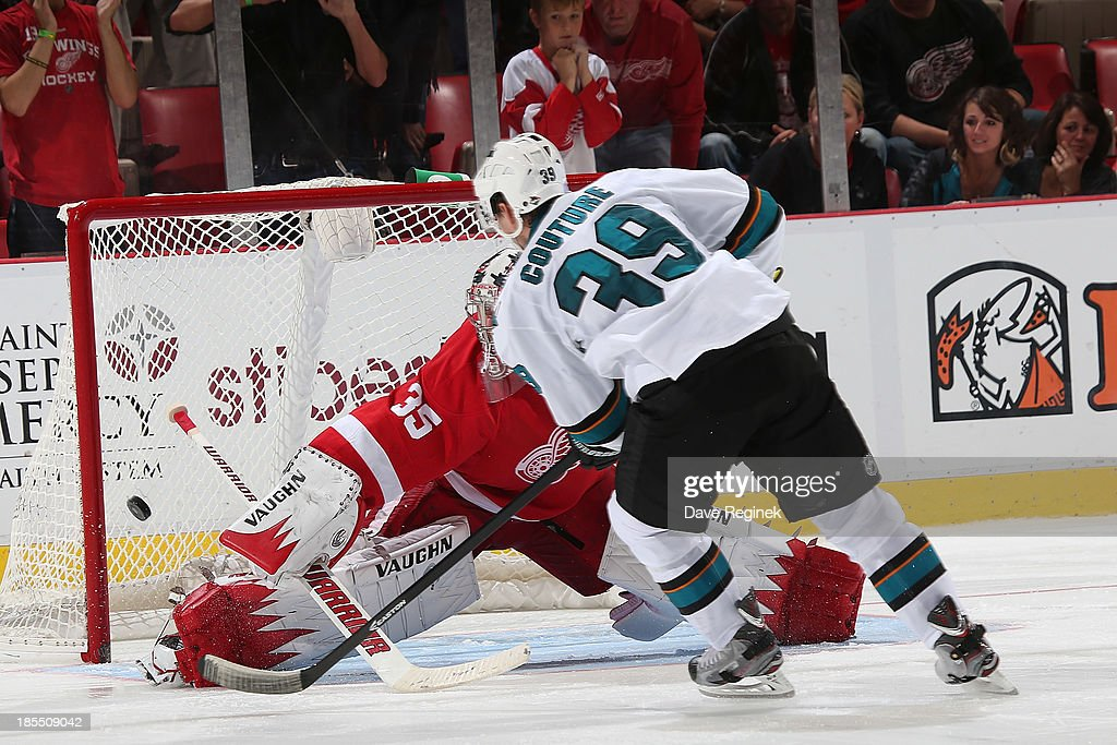 <a gi-track='captionPersonalityLinkClicked' href=/galleries/search?phrase=Logan+Couture&family=editorial&specificpeople=809700 ng-click='$event.stopPropagation()'>Logan Couture</a> #39 of the San Jose Sharks scores the game winning goal in a shoot-out on <a gi-track='captionPersonalityLinkClicked' href=/galleries/search?phrase=Jimmy+Howard&family=editorial&specificpeople=2118637 ng-click='$event.stopPropagation()'>Jimmy Howard</a> #35 of the Detroit Red Wings during an NHL game at Joe Louis Arena on October 21, 2013 in Detroit, Michigan. The Sharks won 1-0