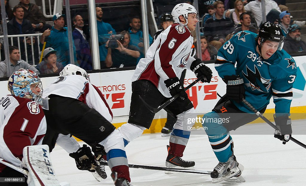 <a gi-track='captionPersonalityLinkClicked' href=/galleries/search?phrase=Logan+Couture&family=editorial&specificpeople=809700 ng-click='$event.stopPropagation()'>Logan Couture</a> #39 of the San Jose Sharks sets up for a shot against <a gi-track='captionPersonalityLinkClicked' href=/galleries/search?phrase=Erik+Johnson+-+Ice+Hockey+Player&family=editorial&specificpeople=457696 ng-click='$event.stopPropagation()'>Erik Johnson</a> #6, <a gi-track='captionPersonalityLinkClicked' href=/galleries/search?phrase=Nate+Guenin&family=editorial&specificpeople=3948510 ng-click='$event.stopPropagation()'>Nate Guenin</a> #5 and <a gi-track='captionPersonalityLinkClicked' href=/galleries/search?phrase=Semyon+Varlamov&family=editorial&specificpeople=6264893 ng-click='$event.stopPropagation()'>Semyon Varlamov</a> #1 of the Colorado Avalanche during an NHL game on December 23, 2013 at SAP Center in San Jose, California.