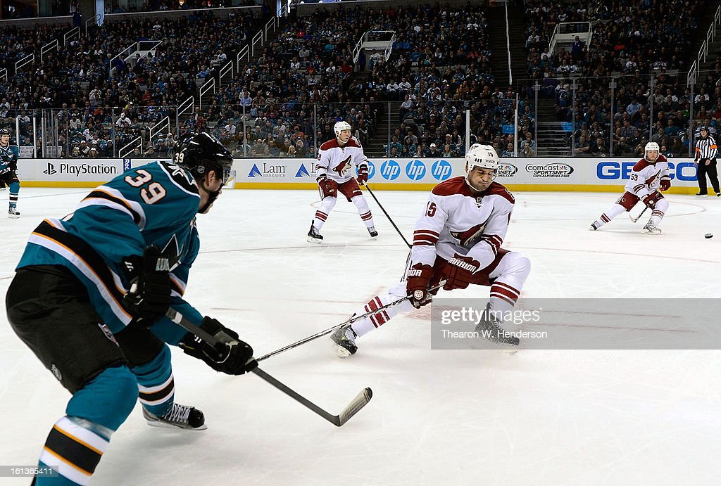 Logan Couture #39 of the San Jose Sharks shoots on goal getting his shot past Boyd Gordon #15 of the Phoenix Coyotes at HP Pavilion on February 9, 2013 in San Jose, California.