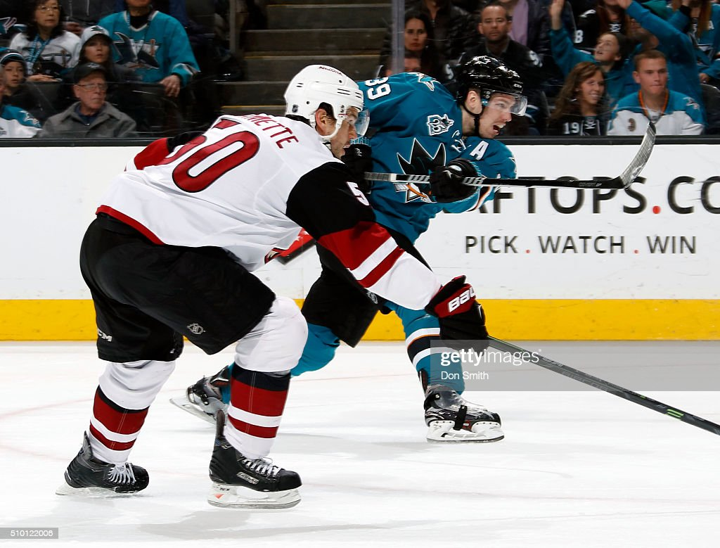 Logan Couture #39 of the San Jose Sharks shoots puck against Antoine Vermette #50 of the Arizona Coyotes during a NHL game at the SAP Center at San Jose on February 13, 2016 in San Jose, California.