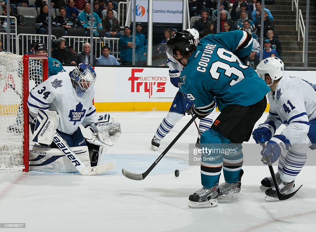 <a gi-track='captionPersonalityLinkClicked' href=/galleries/search?phrase=Logan+Couture&family=editorial&specificpeople=809700 ng-click='$event.stopPropagation()'>Logan Couture</a> #39 of the San Jose Sharks shoots the puck against James Reimer #34 of the Toronto Maple Leafs during an NHL game on March 11, 2014 at SAP Center in San Jose, California.