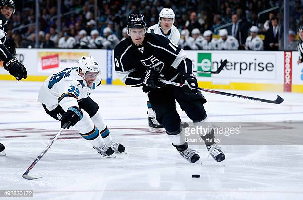 Logan Couture of the San Jose Sharks skates against Christian Ehrhoff of the Los Angeles Kings during a game at Staples Center on October 7 2015 in...