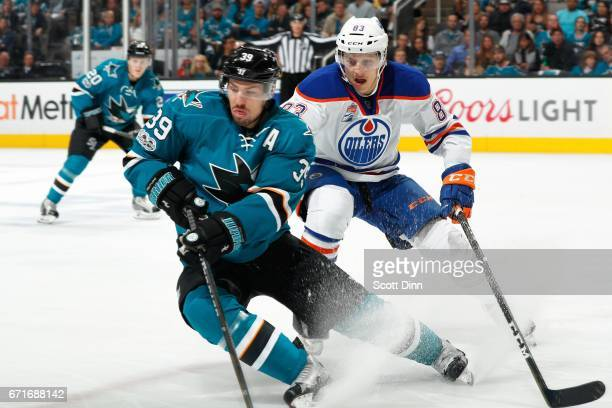 Logan Couture of the San Jose Sharks skates against Matthew Benning of the Edmonton Oilers in Game Six of the Western Conference First Round during...