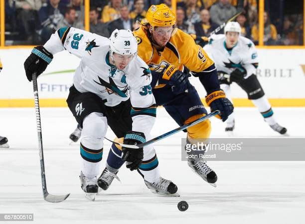 Logan Couture of the San Jose Sharks skates against Ryan Johansen of the Nashville Predators during an NHL game at Bridgestone Arena on March 25 2017...