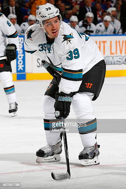 Logan Couture of the San Jose Sharks skates against the New York Islanders at Nassau Veterans Memorial Coliseum on October 16 2014 in Uniondale New...