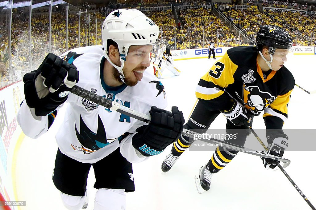 Logan Couture #39 of the San Jose Sharks skates alongside Olli Maatta #3 of the Pittsburgh Penguins in the second period in Game Five of the 2016 NHL Stanley Cup Final at Consol Energy Center on June 9, 2016 in Pittsburgh, Pennsylvania.