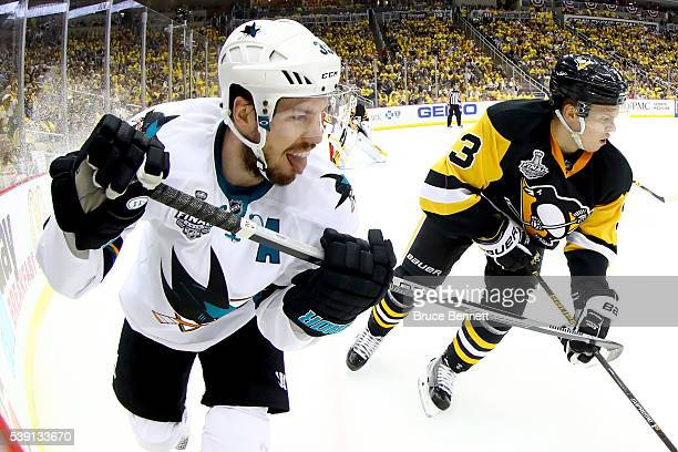 Logan Couture of the San Jose Sharks skates alongside Olli Maatta of the Pittsburgh Penguins in the second period in Game Five of the 2016 NHL...