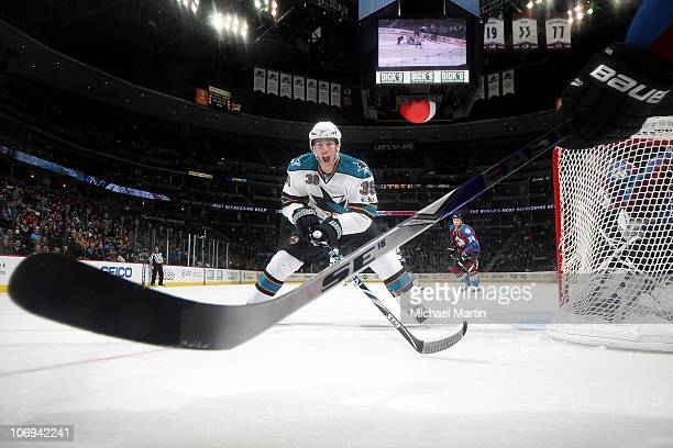 Logan Couture of the San Jose Sharks skates towards a member of the Colorado Avalanche at the Pepsi Center on November 17 2010 in Denver Colorado...