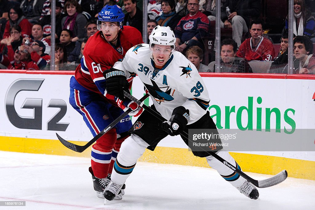 <a gi-track='captionPersonalityLinkClicked' href=/galleries/search?phrase=Logan+Couture&family=editorial&specificpeople=809700 ng-click='$event.stopPropagation()'>Logan Couture</a> #39 of the San Jose Sharks skates while being defended by <a gi-track='captionPersonalityLinkClicked' href=/galleries/search?phrase=Raphael+Diaz&family=editorial&specificpeople=5333791 ng-click='$event.stopPropagation()'>Raphael Diaz</a> #61 of the Montreal Canadiens during the NHL game at the Bell Centre on October 26, 2013 in Montreal, Quebec, Canada. The Sharks defeated the Canadiens 2-0.