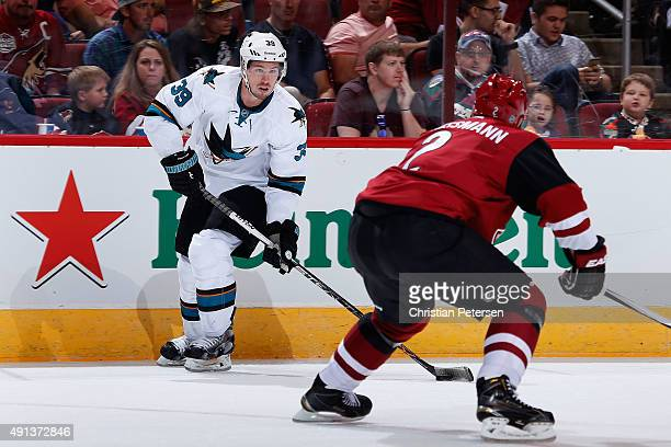 Logan Couture of the San Jose Sharks skates with the puck during the NHL preseason game against the Arizona Coyotes at Gila River Arena on October 2...