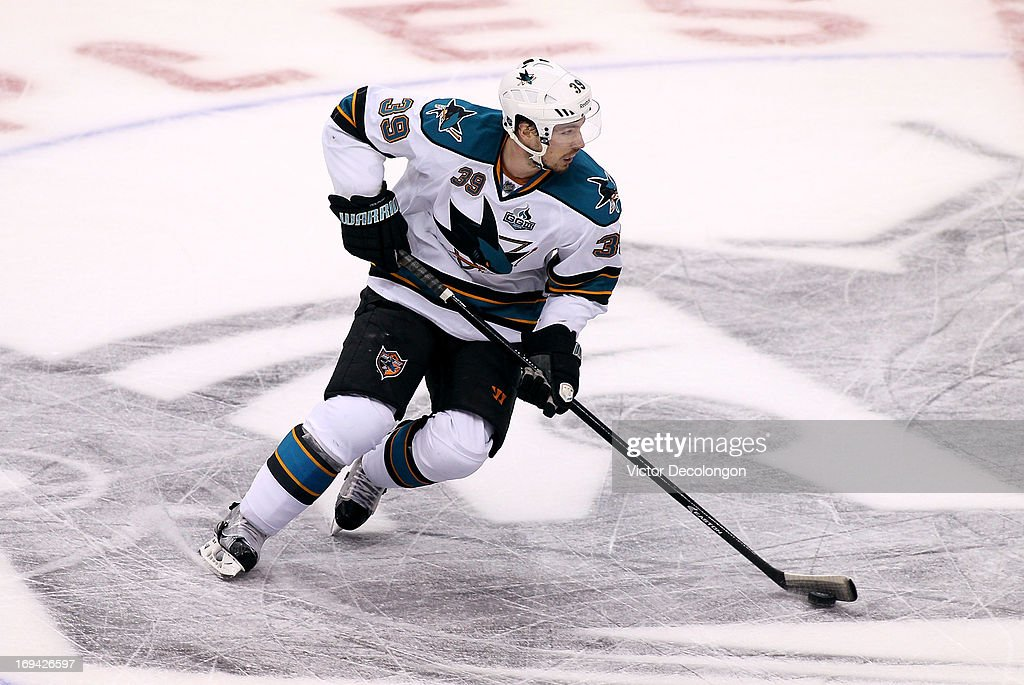 <a gi-track='captionPersonalityLinkClicked' href=/galleries/search?phrase=Logan+Couture&family=editorial&specificpeople=809700 ng-click='$event.stopPropagation()'>Logan Couture</a> #39 of the San Jose Sharks stickhandles the puck through the neutral zone in the third period of Game Five of the Western Conference Semifinals against the Los Angeles Kings during the 2013 NHL Stanley Cup Playoffs at Staples Center on May 23, 2013 in Los Angeles, California. The Kings defeated the Sharks 3-0.