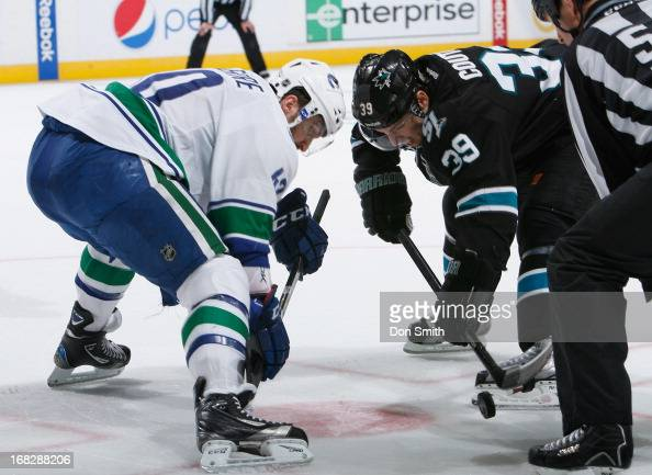 Logan Couture of the San Jose Sharks takes a faceoff against Maxim Lapierre of the Vancouver Canucks in Game Four of the Western Conference...