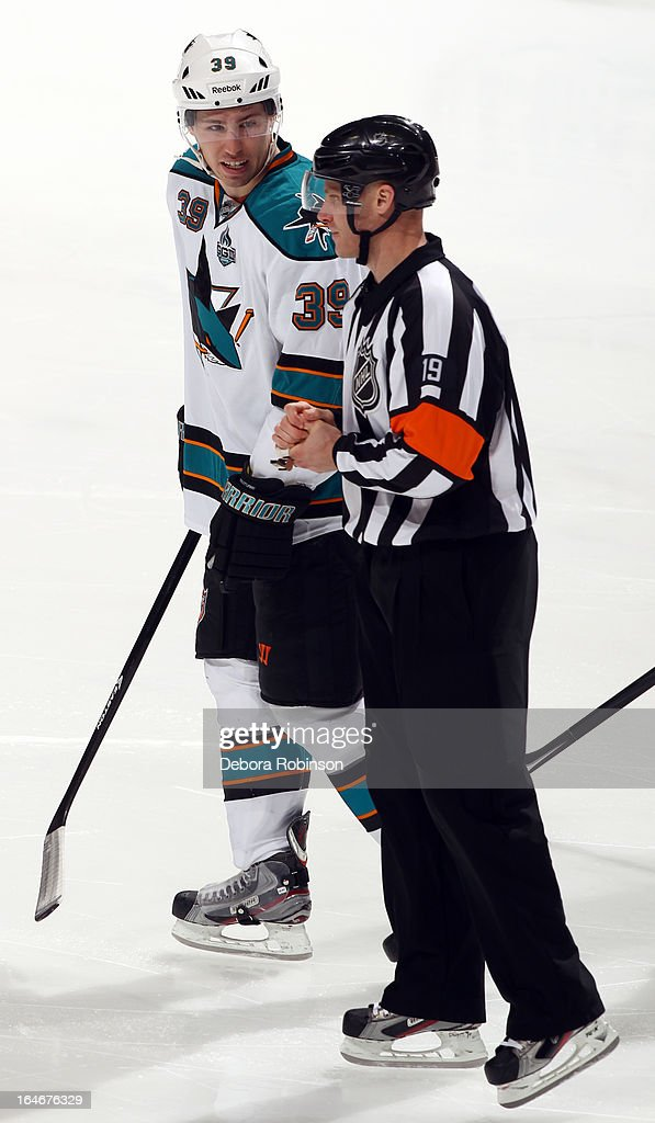 <a gi-track='captionPersonalityLinkClicked' href=/galleries/search?phrase=Logan+Couture&family=editorial&specificpeople=809700 ng-click='$event.stopPropagation()'>Logan Couture</a> #39 of the San Jose Sharks talks with referee Gord Dwyer during the game against the Anaheim Ducks on March 25, 2013 at Honda Center in Anaheim, California.