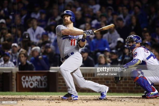 Logan Forsythe of the Los Angeles Dodgers hits a double in the fourth inning against the Chicago Cubs during game five of the National League...