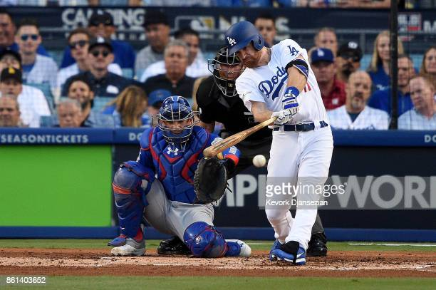 Logan Forsythe of the Los Angeles Dodgers hits a single against Jose Quintana of the Chicago Cubs during the second inning in Game One of the...