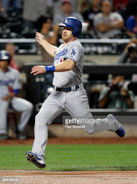 Logan Forsythe of the Los Angeles Dodgers scores a run in the first inning of an MLB baseball game against the New York Mets on August 6 2017 at...