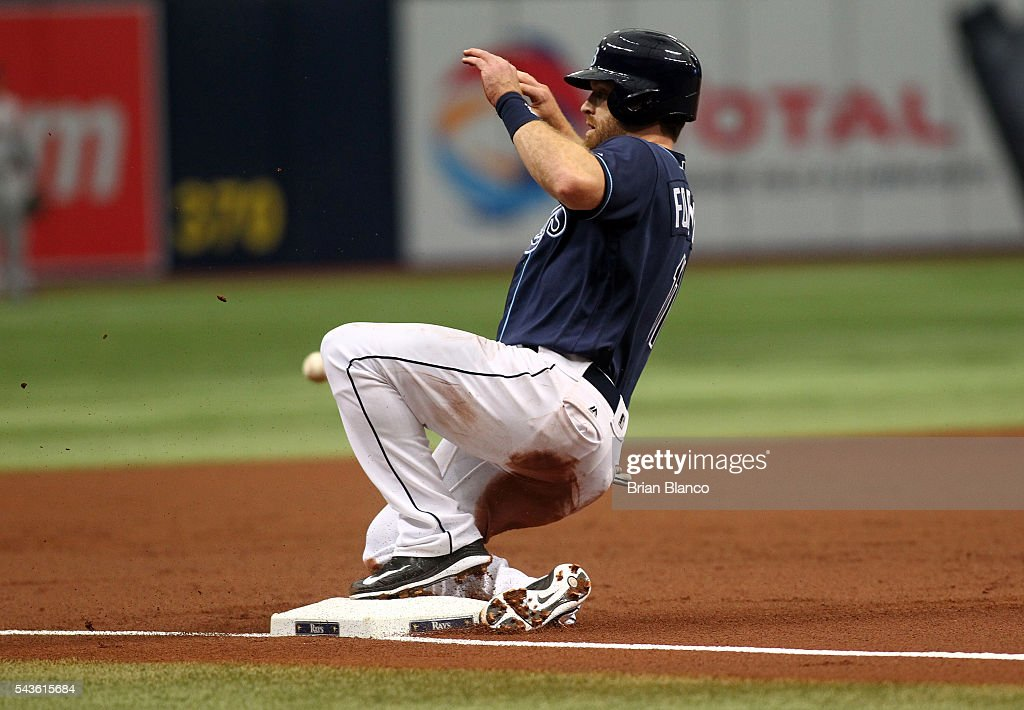 <a gi-track='captionPersonalityLinkClicked' href=/galleries/search?phrase=Logan+Forsythe&family=editorial&specificpeople=4412508 ng-click='$event.stopPropagation()'>Logan Forsythe</a> #11 of the Tampa Bay Rays advances to third base off the fly ball to center field by Brad Miller during the first inning of a game against the Boston Red Sox on June 29, 2016 at Tropicana Field in St. Petersburg, Florida.