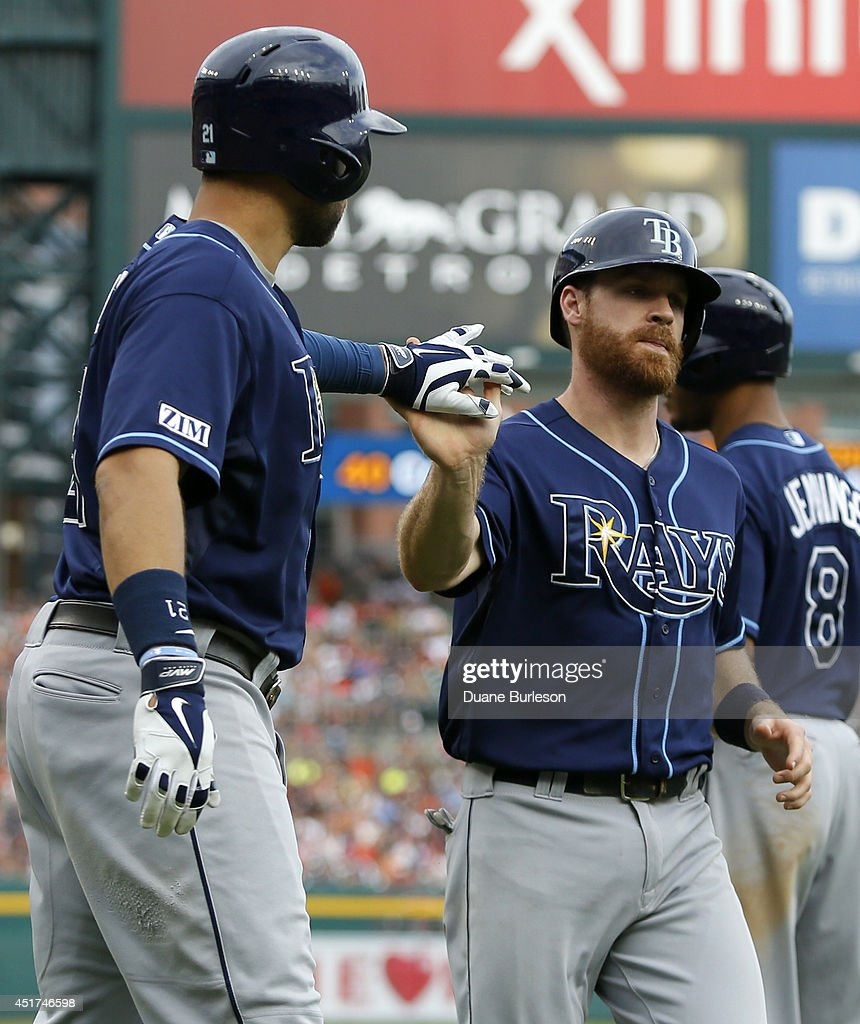 Logan Forsythe #10 of the Tampa Bay Rays and James Loney #21, left, celebrate after scoring on a triple by Kevin Kiermaier during the sixth inning of a game against the Detroit Tigers at Comerica Park on July 5, 2014 in Detroit, Michigan. The Rays defeated the Tigers 7-2.