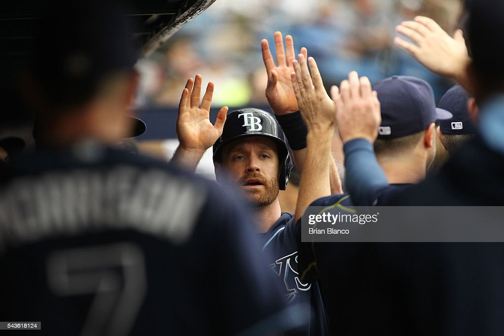 <a gi-track='captionPersonalityLinkClicked' href=/galleries/search?phrase=Logan+Forsythe&family=editorial&specificpeople=4412508 ng-click='$event.stopPropagation()'>Logan Forsythe</a> #11 of the Tampa Bay Rays celebrates with teammates in the dugout after scoring off of an RBI double by Evan Longoria during the third inning of a game against the Boston Red Sox on June 29, 2016 at Tropicana Field in St. Petersburg, Florida.