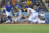 Logan Forsythe of the Tampa Bay Rays scores on a wild pitch and under the tag of Luis Avilan of the Los Angeles Dodgers in the eighth inning of the...