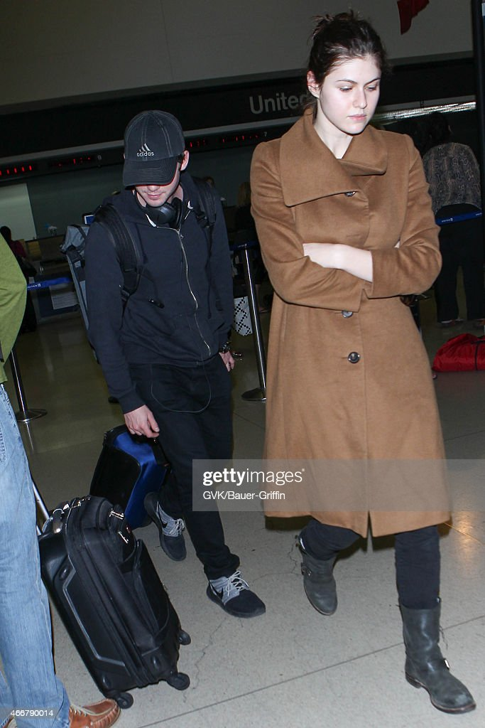 Logan Lerman and Alexandra Daddario seen at LAX on March 18 2015 in Los Angeles California