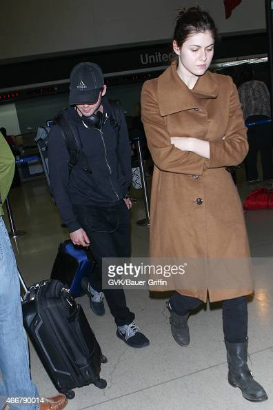 Logan Lerman and Alexandra Daddario seen at LAX on March 18 2015 in Los Angeles California