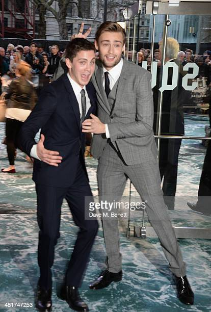 Logan Lerman and Douglas Booth attend the UK Premiere of 'Noah' at Odeon Leicester Square on March 31 2014 in London England
