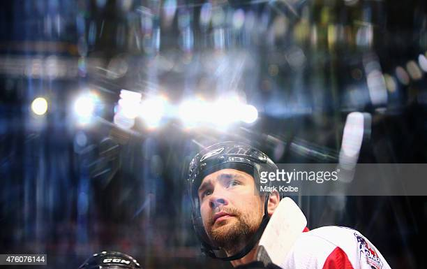 Logan MacMillan Of Canada watches on before the start of play during the 2015 Ice Hockey Classic match between the Unites States and Canada at...