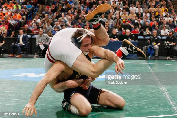 Logan Massa of Michigan wrestles Isaac Jordan of Wisconsin in the 3rd place 165lb match during the Division 1 Men's Wrestling Championships held at...