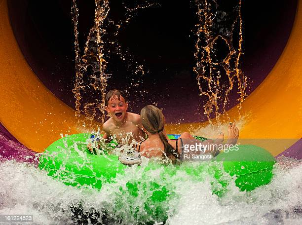 Logan Miller with his mother Celeste ride Elitch Gardens Theme Water Park's newest thrill ride Tube Top Tuesday May 22 during a VIP opening for the...