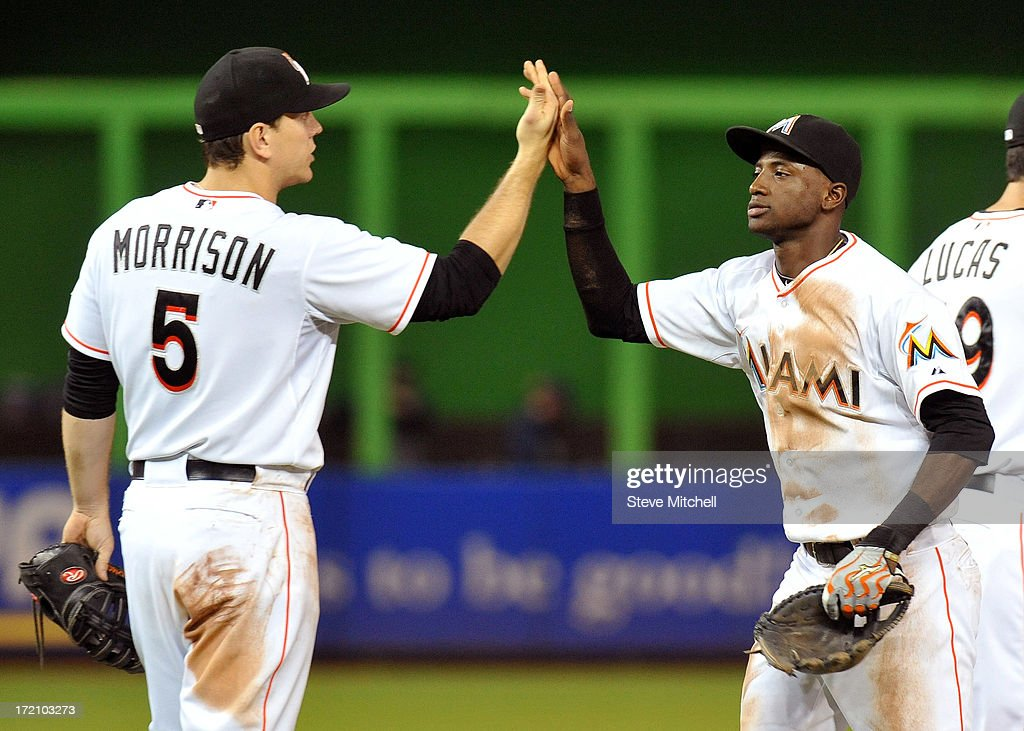 Logan Morrison #5 of the Miami Marlins celebrates with <a gi-track='captionPersonalityLinkClicked' href=/galleries/search?phrase=Adeiny+Hechavarria&family=editorial&specificpeople=6926508 ng-click='$event.stopPropagation()'>Adeiny Hechavarria</a> #3 of the Miami Marlins after defeating the San Diego Padres 4-0 at Marlins Park on July 1, 2013 in Miami, Florida.