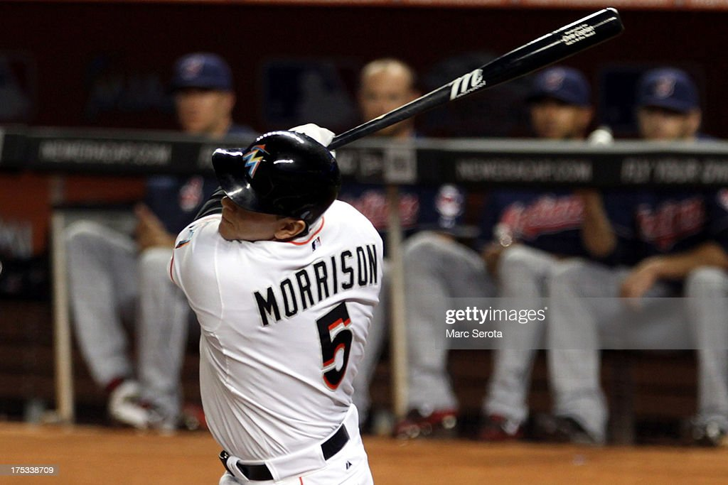 Logan Morrison #5 of the Miami Marlins hits an RBI single against the Cleveland Indians during the second inning at Marlins Park on August 2, 2013 in Miami, Florida.