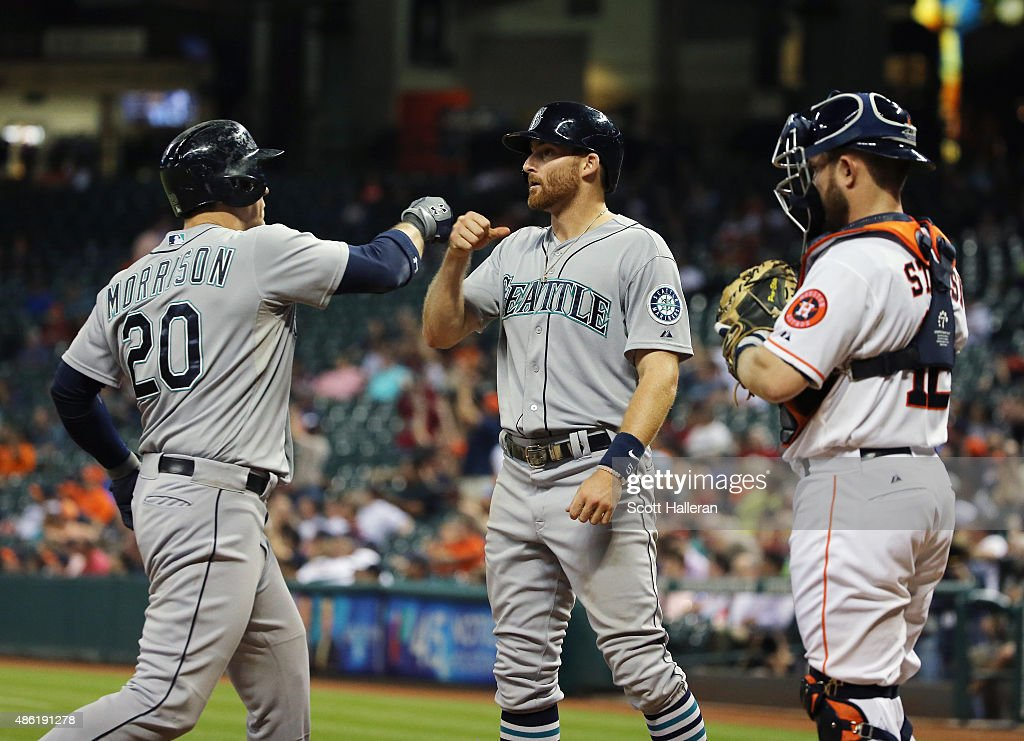 Logan Morrison of the Seattle Mariners is greeted by Brad Miller after Morrison hit a tworun home run in the eighth inning of their game against the...