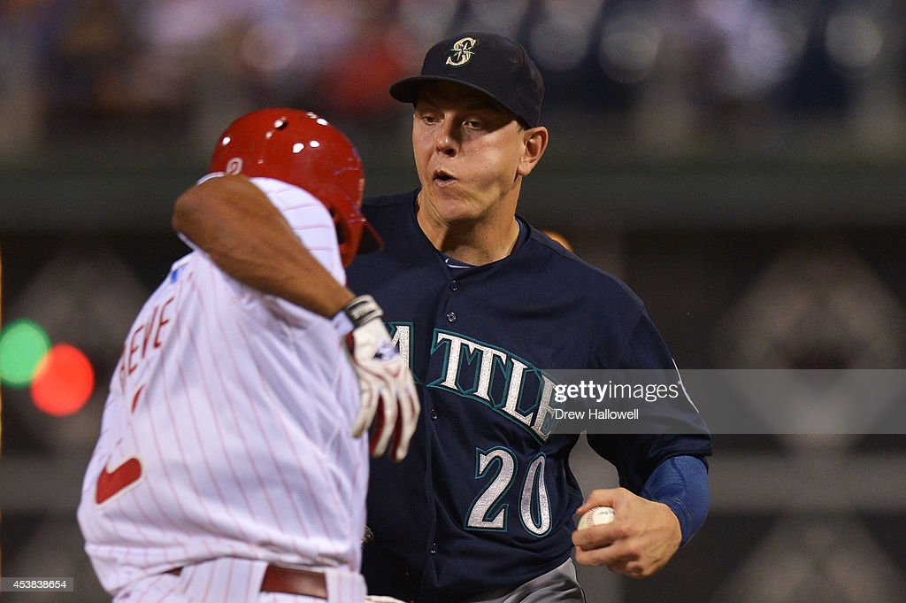 Logan Morrison #20 of the Seattle Mariners tags out Ben Revere #2 of the Philadelphia Phillies in the eighth inning at Citizens Bank Park on August 19, 2014 in Philadelphia, Pennsylvania. The Mariners won 5-2.