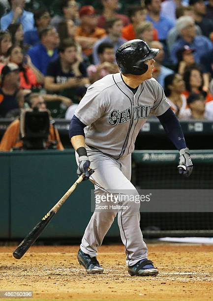 Logan Morrison of the Seattle Mariners watches his threerun home run in the ninth inning of their game against the Houston Astros at Minute Maid Park...