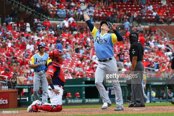Logan Morrison of the Tampa Bay Rays celebrates after hitting the gamewinning home run against the St Louis Cardinals in the 10th inning at Busch...
