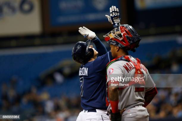Logan Morrison of the Tampa Bay Rays celebrates his home run at home plate in front of catcher Martin Maldonado of the Los Angeles Angels during the...