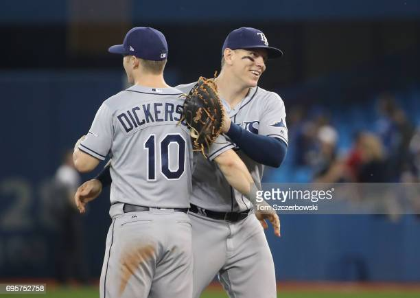 Logan Morrison of the Tampa Bay Rays celebrates their victory with Corey Dickerson during MLB game action against the Toronto Blue Jays at Rogers...