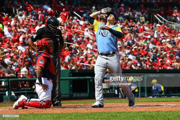 Logan Morrison of the Tampa Bay Rays crosses home plate after hitting a home run against the St Louis Cardinals in the fourth inning at Busch Stadium...